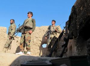 ANA soldiers stand at an outpost in Helmand province