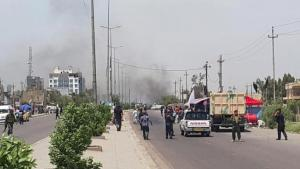 Smoke rises from a car bomb attack in the Saydiya district of southern Baghdad