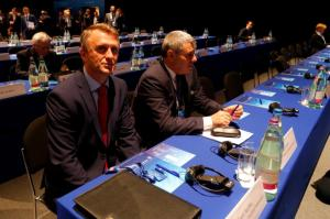 Representatives of the Kosovo Soccer Federation Salihu and Vokrri wait to start the 40th Ordinary UEFA Congress in Budapest