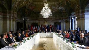Russian Foreign Minister Lavrov, U.S. Secretary of State Kerry and U.N. envoy de Mistura attend a meeting in Vienna
