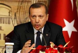 Turkish President Recep Tayyip Erdogan gestures during a news conference.