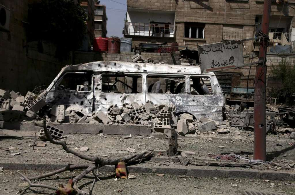 Monitor: More than 120 Dead in Multiple Blasts in Syria Regime Strongholds