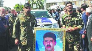 Iranian regime members at the funeral service of one of the Quds Force officers killed at the Kermenshah offensive