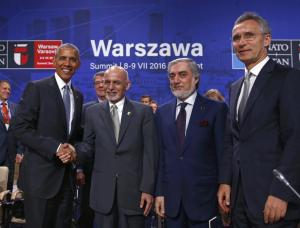 U.S. President Obama shakes hands with Afghanistan's President Ghani next to NATO Secretary General Stoltenberg and Afghanistan's Chief Executive Abdullah Abdullah at the NATO Summit in Warsaw