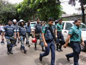 Security personnel are seen near the Holey Artisan restaurant hostage site, in Dhaka, Bangladesh
