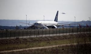 Saudi Arabian Airlines flight SVA 226 is isolated on the tarmac after its passengers and crew were evacuated following a bomb threat, at the Barajas airport in Madrid, Spain, February 4, 2016. REUTERS/Andrea Comas