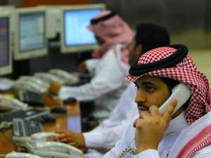 Fahad ShadeedSaudi traders monitor stocks at the Saudi Investment Bank in Riyadh August 7, 2011, Reuters