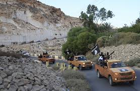 Militants from Derna, photographed shortly after pledging allegiance to Isis in OctoberReuters