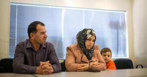 Madiha Algothany and her husband, Mahmoud al-Rifai, and one of their children in Baltimore. Credit Gabriella Demczuk for The New York Times