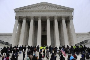 Police form a line after arresting demonstrators on the steps of the U.S. Supreme Court, on the anniversary of the Citizens United decision, in Washington, January 20, 2012. REUTERS/Jonathan Ernst