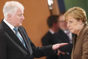 Bavarian Prime Minister and head of the Christian Social Union Horst Seehofer talks with German Chancellor Angela Merkel prior to a meeting of German state leaders to discuss the migrant crisis, in Berlin in this December 3,2015 file picture. REUTERS/Hannibal Hanschke/Files