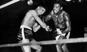 Randolph Turpin buckles under a blow from Sugar Ray Robinson during their world middleweight title fight in New York. Photograph: Hulton Archive/Getty Images