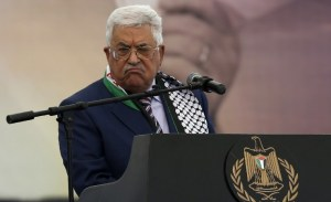 Palestinian Authority president Mahmoud Abbas gestures as he gives a speech during a rally marking the 12th anniversary of the death of late Palestinian leader Yasser Arafat in the West Bank city of Ramallah on November 10, 2016.