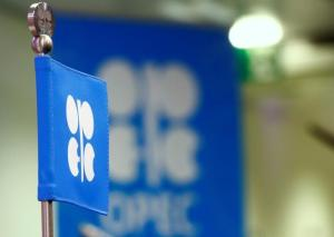 The OPEC flag and the OPEC logo are seen before a news conference in Vienn