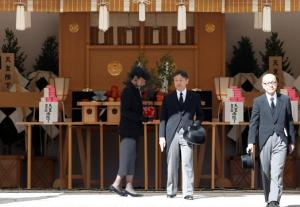 Japan's Crown Prince Naruhito and Crown Princess Masako walk after praying at the altar during the funeral of late Prince Mikasa, uncle of the current Emperor Akihito, at the Toshimagaoka cemetery in Tokyo