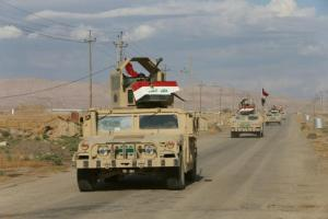 Military vehicles of Iraqi army take part in an operation against ISIS militants in Qaraqosh