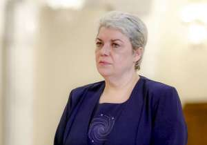 In this photo taken May 20, 2015, Sevil Shhaideh, 52, stands at the Romanian presidency before being sworn in as regional development minister in Bucharest, Romania.