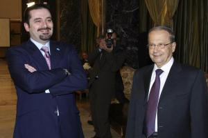 Lebanon's Parliament majority leader al-Hariri and Lebanese opposition Christian leader Aoun smile during the sixth session of the national dialogue between politician rival leaders in Baabda