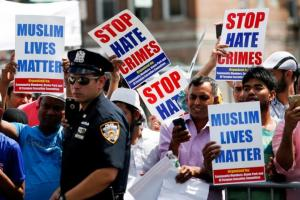 Community members take part in a protest to demand stop hate crime during the funeral service of Maulama Akonjee, and Uddin in the Queens borough of New York City