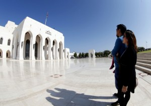 Tourists stand in front of the Royal Opera House in Omani capital Muscat (AFP)