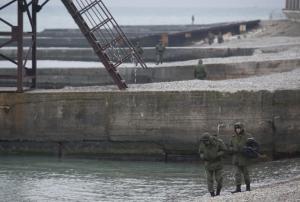 Russian servicemen stand at shores of Black Sea near crash site of Russian military Tu-154 plane, in Sochi suburb of Khosta