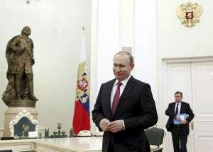 Russia's President Vladimir Putin attends a meeting with Qatar's Emir Sheikh Tamim Bin Hamad Al-Thani in Moscow