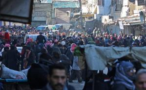 People gather to be evacuated from al-Sukkari rebel-held sector of eastern Aleppo, Syria December 15, 2016. REUTERS/Abdalrhman Ismail
