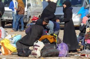 Evacuees from a rebel-held area of Aleppo arrive at insurgent-held al-Rashideen