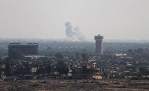 Smoke rises in Egypt's North Sinai as seen from the border of southern Gaza Strip with Egypt