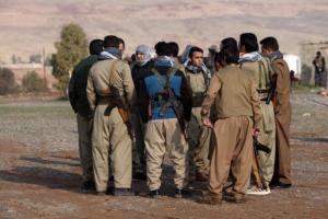 Members of the Democratic Party of Iranian Kurdistan (PDKI) gather during a funeral of victims who were killed in a bomb attack at the offices of the PDKI in Koy Sanjak, east of Erbil