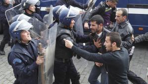 Riot police break up a previous protest in Algeria.
