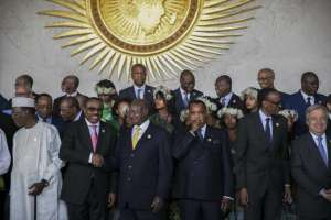 Leaders gathered for a group photo at the 28th ordinary session of the assembly of the African Union in Addis Ababa, Ethiopia, on Monday. PHOTO: MULUGETA AYENE/ASSOCIATED PRES