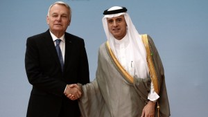 French Foreign Minister Jean-Marc Ayrault shakes hands with Saudi Foreign Minister Adel al-Jubeir. AP