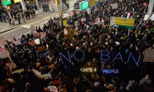 Protests outside Terminal 4 at JFK airport where two Iraqis were detained despite holding valid visas Getty Images