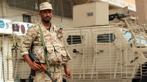 Yemeni army soldier stands guard as he secures a street in Mansoura district of Yemen's southern port city of Aden