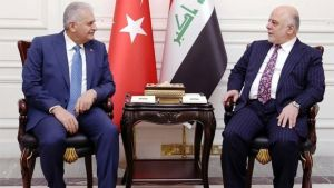 A handout picture released by the Iraq Prime Minister's Press Office on January 7, 2017, shows Iraqi Prime Minister Haidar al-Abadi (R) meeting with his Turkish counterpart Binali Yildirim in the capital Baghdad.