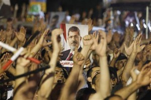 Members of the Muslim Brotherhood and supporter of ousted Egyptian President Mohamed Mursi shouts slogans at the Raba El-Adwyia mosque square in Cairo July 4, 2013.