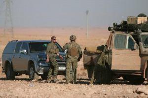 U.S. fighters stand near military vehicles, north of Raqqa city, Syria November 6, 2016