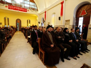 Ammar al-Hakim, leader of the Islamic Supreme Council of Iraq (ISCI), attends a mass on Christmas at Mar George Chaldean Church in Baghdad