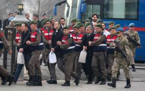 Turkish soldiers accused of attempting to assassinate President Erdogan on the night of the failed July 15 coup, are escorted by gendarmes as they arrive for the first hearing of the trial in Mugla