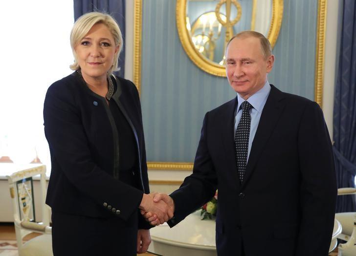 Far Right Leader Le Pen Meets Russia's Putin, Criticizes Upholding Sanctions