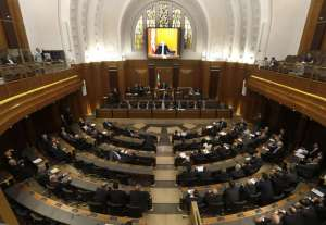 Lebanese lawmakers meet in the Lebanese Parliament during a session to debate whether to extend their term 17 months, in Beirut, Lebanon, Friday May 31, 2013.
