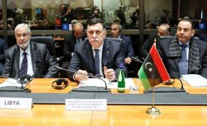 Serraj, President of the Presidency Council of the Government of National Accord of Libya sits next to Libya's Foreign Minister Siala and Interior Minister El Khoja during a meeting in Rome