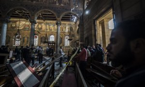 Egyptian security forces inspect the scene of a bomb explosion at the Saint Peter and Saint Paul Coptic Orthodox Church in Cairo on December 11, 2016. AFP/KHALED DESOUKI