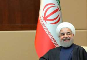 Iranian President Hassan Rouhani smiles in Ankara during a visit to Turkey on April 15. Reuters