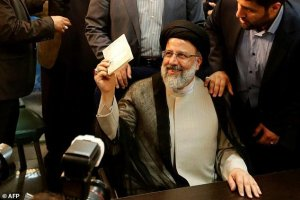 Iranian cleric Ebrahim Raisi gestures after registering his candidacy for the upcoming presidential elections at the ministry of the interior in Tehran on April 14, 2017