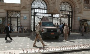 Yemeni soldiers stand guard outside the cabinet headquarters during the weekly parliament session with Yemeni ministers.