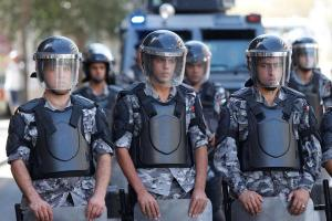 Jordanian police stand guard during a protest against a government agreement to import natural gas from Israel, in Amman
