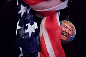 Flag scarf and button on a Donald Trump supporter at a campaign event.