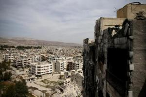 A general view shows damaged buildings as seen from the rebel held Qaboun neighborhood of Damascus